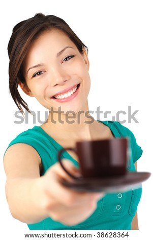 Coffee. Beautiful young woman with big smile serving an espresso. Cup is sharp, model out of focus. Isolated on white.