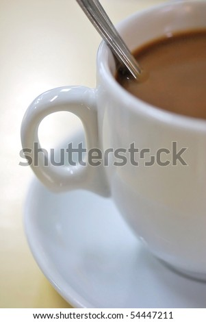 Coffee beverage in white cup and saucer. For food and beverage, and diet and nutrition concepts.