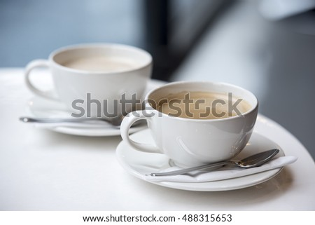 Coffee brake set: two cups of coffee with spoons #488315653