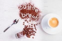 coffee break concept - cup of espresso, spoon and coffee break lettering