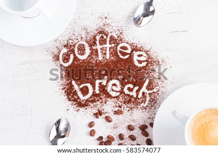 coffee break concept - cups of espresso, spoons and coffee break lettering