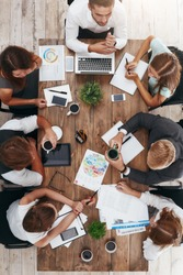 Coffee break during business meeting. Vertical shot
