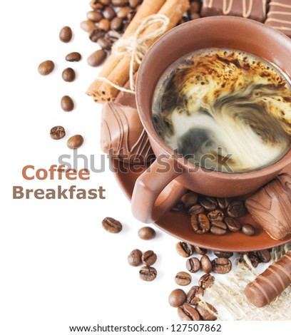 Coffee breakfast (cup of coffee, cinnamon, chocolate candy and coffee beans isolated on white background with sample text)