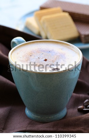 coffee cappuccino in a  blue ceramic cup