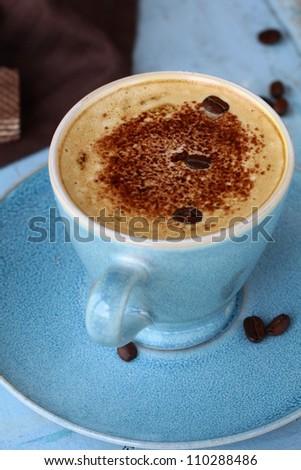 coffee cappuccino in a trendy blue ceramic cup