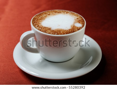 Coffee cappuccino on a red background