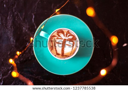 COFFEE Cappuccino with a picture of a gift on milk foam