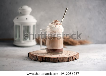 Coffee cocktail mocha with whipped cream on a wooden tray on a stone gray background. Delicious homemade sweet dessert of coffee with milk and cocoad. Stock fotó ©