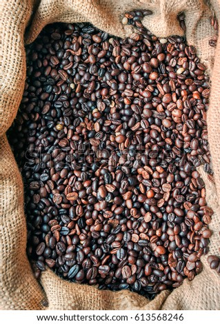 Coffee concept. Sac with roasted coffee beans #613568246
