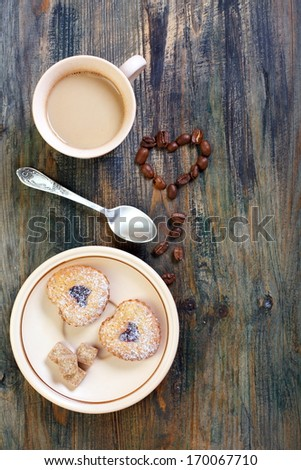 Coffee, cookies and heart of coffee beans on a wooden table.  #170067710