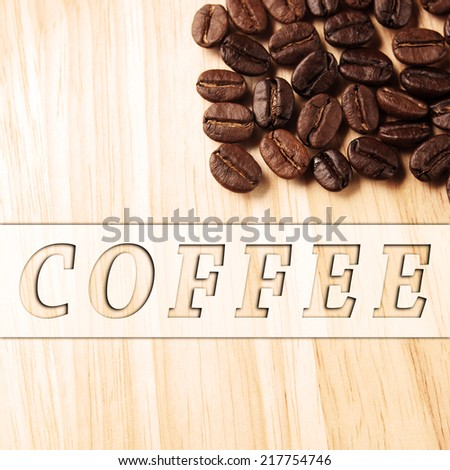 Coffee crop beans and coffee banner label on wood texture background