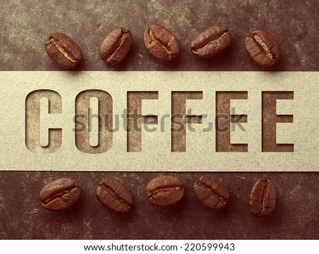 Coffee crop beans with paper and text on wood texture, vintage color background