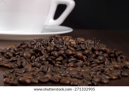 Coffee crops texture and coffee cup and plate on a black background