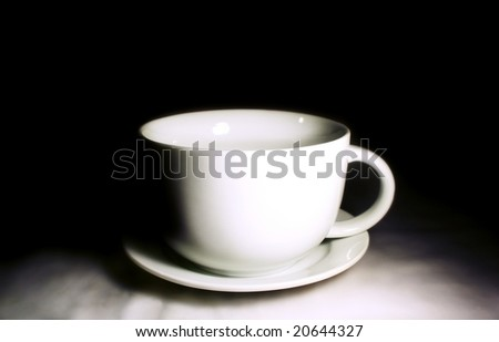 coffee cup against dark background