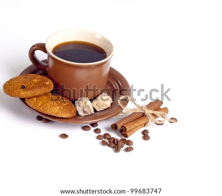 coffee cup and beans, cinnamon sticks, cookies, sugar