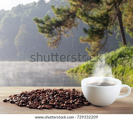 coffee cup and beans lake background #729332209