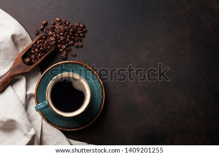 Coffee cup and beans on old kitchen table. Top view with copyspace for your text