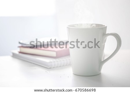 coffee cup and blurred book #670586698