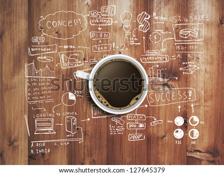 coffee cup and business strategy on wooden table #127645379