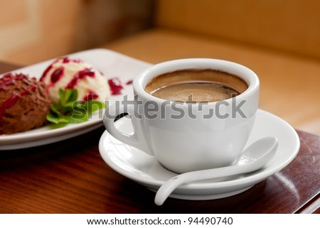 coffee cup and ice cream on restaurant table