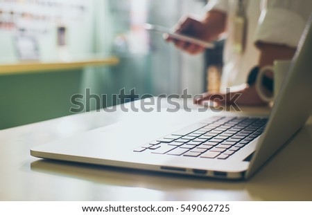Coffee cup and laptop for business.close up Seleted focus. #549062725