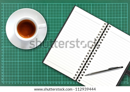 coffee cup and notebook with pen k