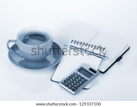 Coffee cup and office supplies. Blue toned