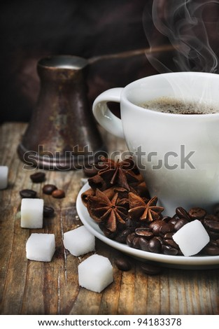 Coffee cup and old-fashion coffee pot on wooden plank