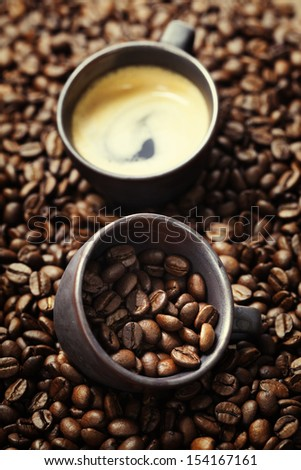 Coffee cup and roasted coffee beans