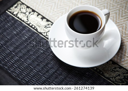 Coffee cup and saucer on old wooden table #261274139