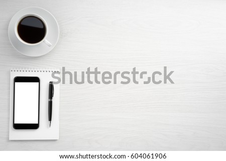 Coffee cup and smartphone top view with copy space