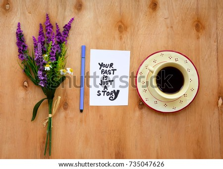 Coffee cup and your past is just a story text on a note on wooden table with lavender flowers #735047626