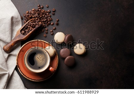 Coffee cup, beans and macaroons on old kitchen table. Top view with copyspace for your text #611988929