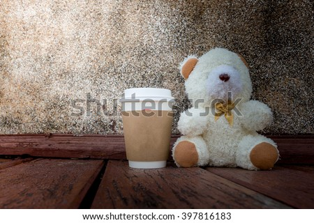 coffee cup,focused on teddy bear face in Blurred background with vintage filter