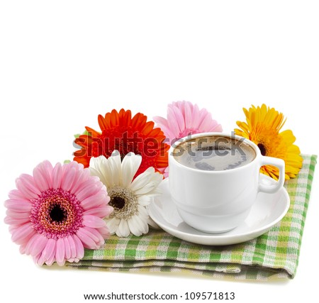 coffee cup in a table serviette on a white background