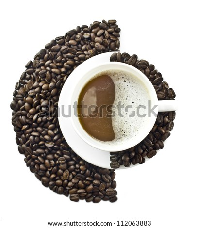 Coffee cup in an environment of Coffee beans