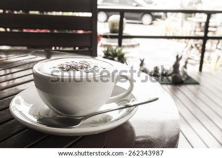 Coffee cup in coffee shop -  Black and White effect picture