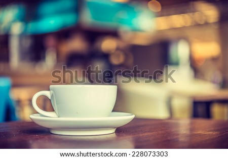 Coffee cup in coffee shop - vintage style effect picture #228073303