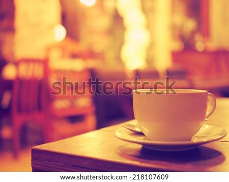 coffee cup in coffee shop vintage warm color tone