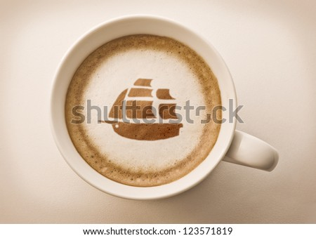 coffee cup latte art with ship drawing - stock photo