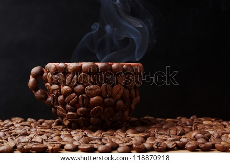 Coffee cup made from coffee beans with smoke   on black