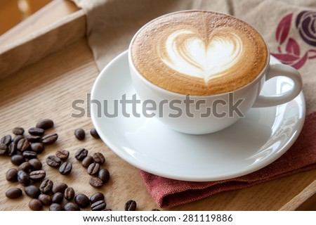 Coffee cup of Cafe' latte with heart latte art on top