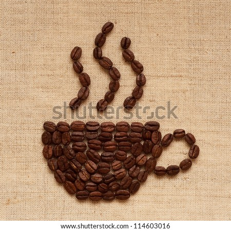 Coffee cup of coffee beans on burlap texture