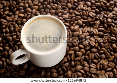 Coffee cup on a coffee grains background