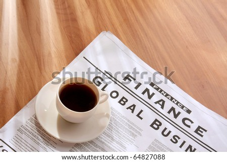 coffee cup on a newspaper