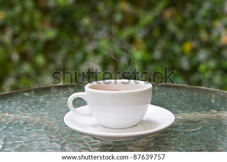 coffee cup on glass table