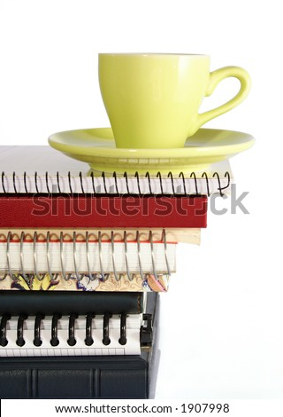 coffee cup on pile of files - stock photo
