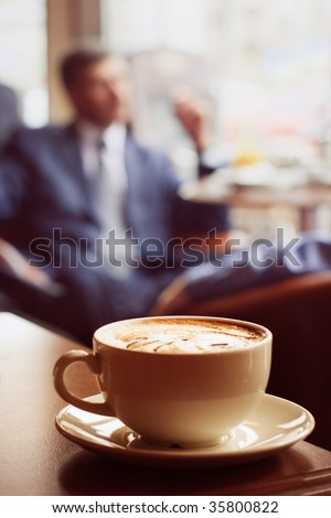 Coffee cup on the edge of the table