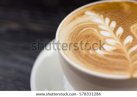 Coffee cup on the table, latte art