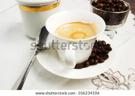 coffee cup on the table with beans